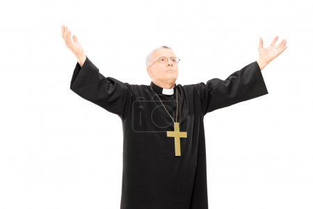 Priest in mantle gesturing with hands