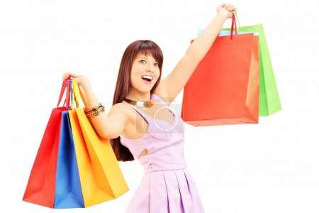Young female holding shopping bags