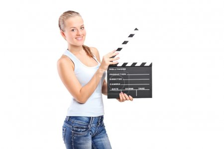 Girl holding movie clap