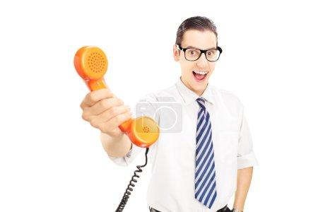 Man giving a telephone tube