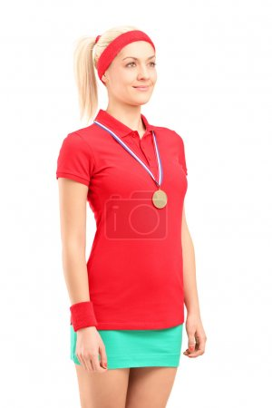 Female tennis player with medal