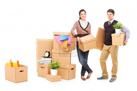 Photo for Young male and female packing boxes, preparing for moving, isolated on white background - Royalty Free Image