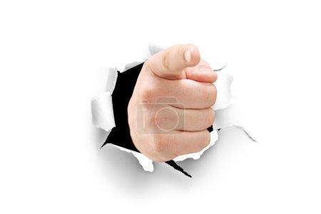 Photo pour Vue d'une main masculine pointant à travers un trou de papier isolé sur fond blanc - image libre de droit