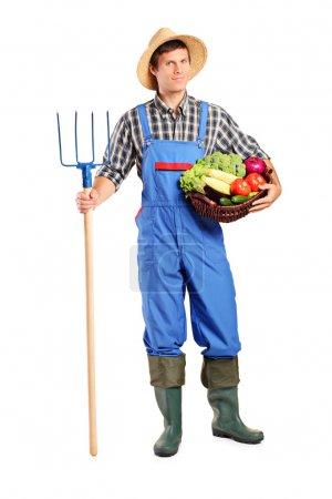 Farmer holding pitchfork