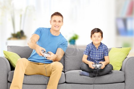 Man playing video game with cousin