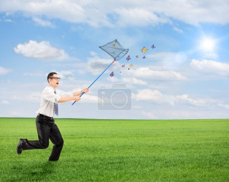 Man running and catching butterflies