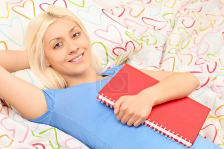 Girl holding notebook