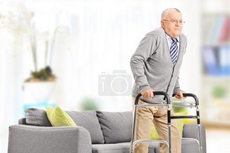 Senior gentleman walking with walker