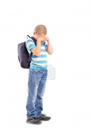 Sad schoolboy crying