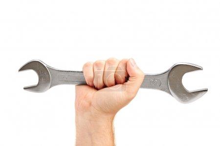 Photo pour Main tenant une clé isolée sur fond blanc - image libre de droit
