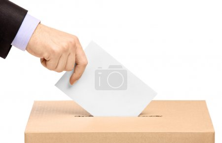 Hand putting voting ballot in box