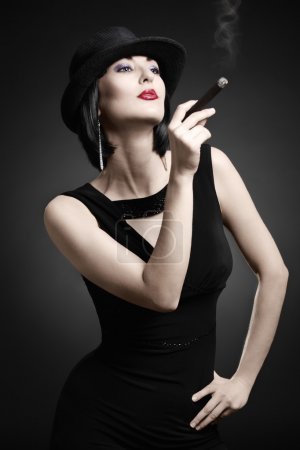 Vintage woman smoking cigar