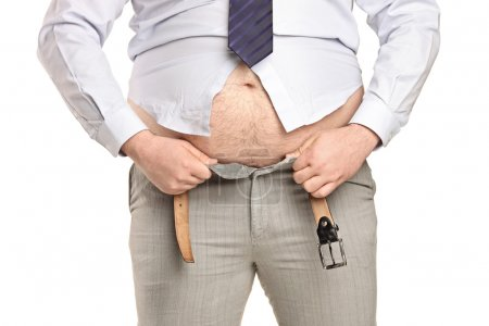 Overweight man trying to fasten clothes