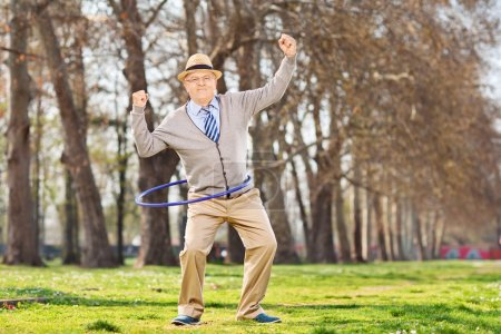 Senior man, exercise with a hula hoop