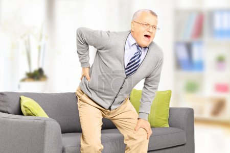 Senior man suffering from back pain