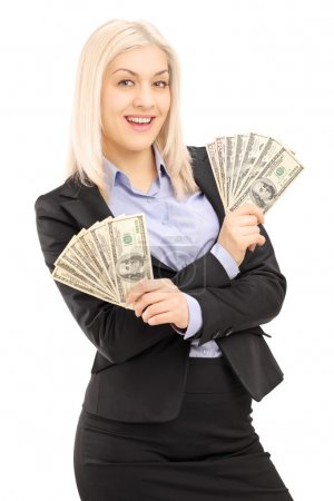 Female in suit holding dollars