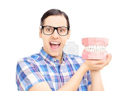 Guy holding dentures