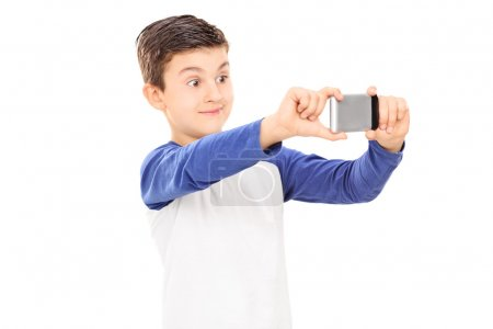 Kid taking selfie with cell phone