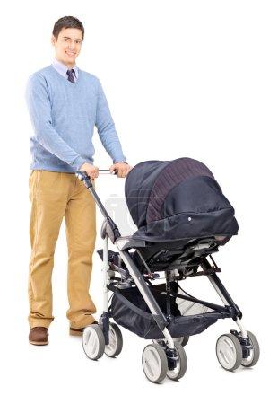 Male pushing baby stroller