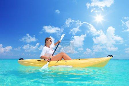 Female kayaking on sunny day