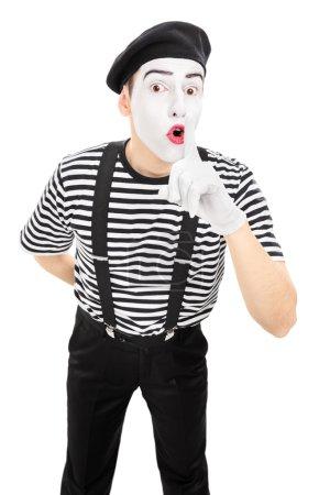 Comedian holding finger on lips