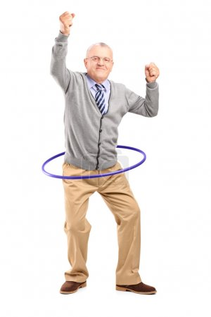 Photo for Full length portrait of a mature gentleman dancing with a hula hoop isolated on white background - Royalty Free Image