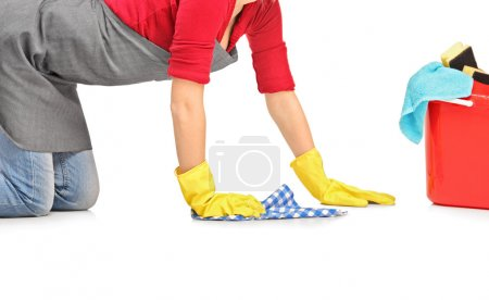 Photo for Female cleaner wiping down and bucket with cleaning supplies isolated on white background - Royalty Free Image