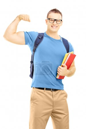 Student with backpack holding books