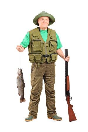 Mature hunter holding fish