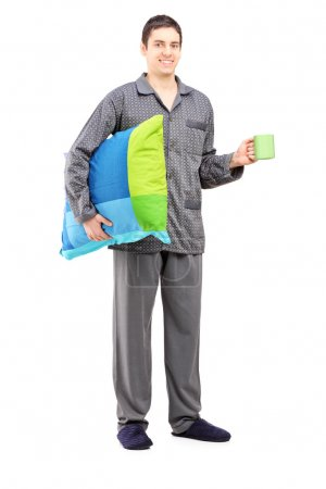 Man holding pillow and cup