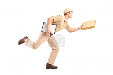 Photo for Full length portrait of a delivery boy in a rush delivering a package isolated against white background - Royalty Free Image