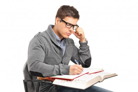 Male in thoughts doing an exam
