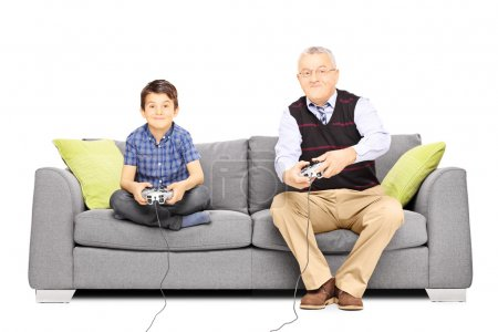 Grandfather with nephew playing video games