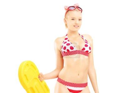 Female in bikini holding swimming float