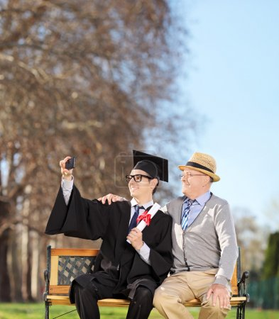 Student and his father taking selfie