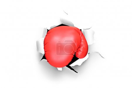 Boxing glove through hole in paper