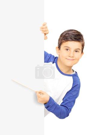 Boy pointing on blank panel