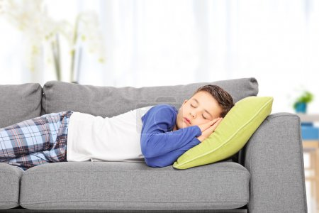 Photo for Cute little boy sleeping on sofa at home - Royalty Free Image
