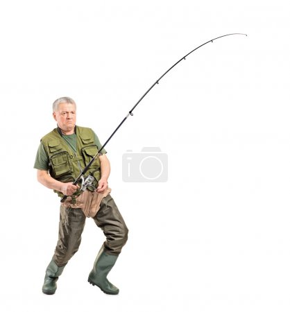 Fisherman holding fishing pole