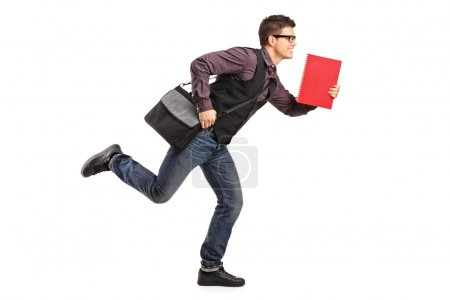 Student in rush running with notebook