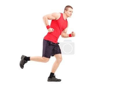 Muscular male athlete running