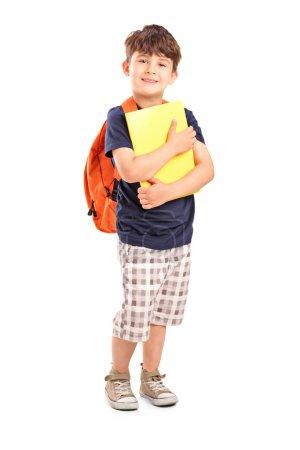School boy holding notebook