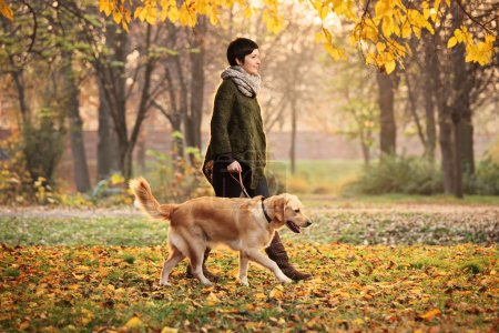 Girl and dog in park