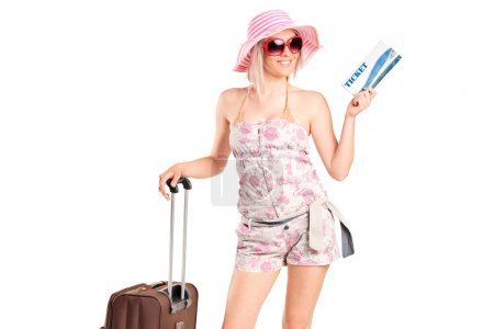 Tourist girl holding ticket and luggage