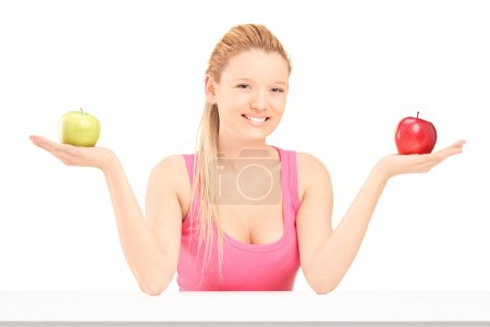 Female holding apples in hands