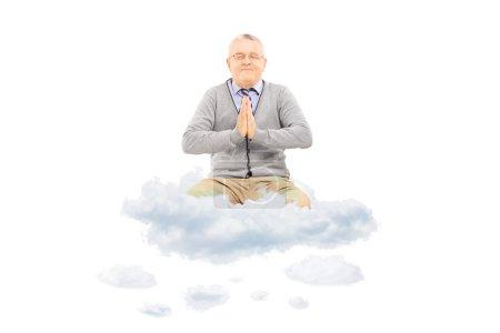 Senior gentleman meditating on clouds