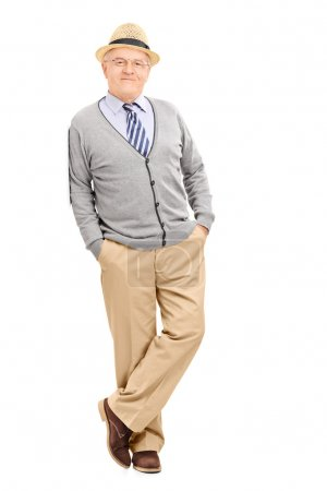 Male pensioner leaning against a wall