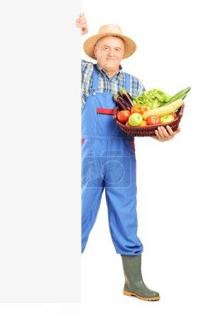 Gardener holding basket full