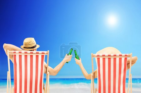 Man and woman relaxing on beach