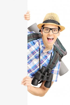 Smiling male tourist with binocular